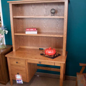 wood desk with shelves above