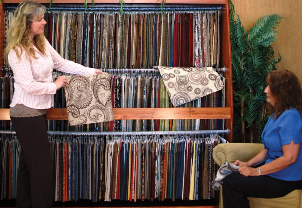 Hands on upholstery fabric comparison at Fireside Furniture. Feel the upholstery fabric.