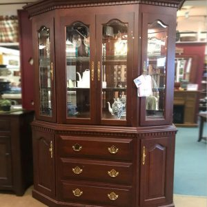 solid cherry American Made Canted Corner Hutch. Built in Ohio to exacting specifications. Features bevel glass, touch canister lighting