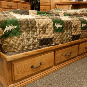 solid wood bedroom set showing underbed storage