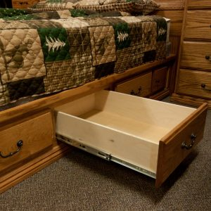 solid wood bedroom set showing underbed storage drawer fully extends