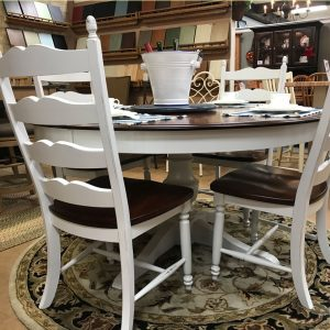 sixty inch rustic-birch round table with ladderback-chairs