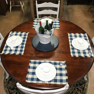 sixty inch rustic-birch round table with ladderback chairs