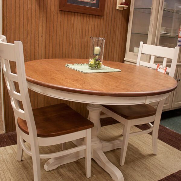 solid cherry 48 inch round dining table with painted ladder backed chairs at fireside side