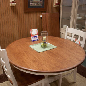 solid cherry 48 inch round dining table with painted ladder backed chairs at fireside top